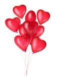 Grupo de globos rojos del corazón Fotografía de archivo