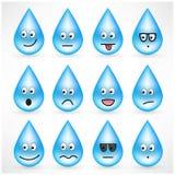 Grupo de gotas com as caras do emoticon do smiley fotografia de stock
