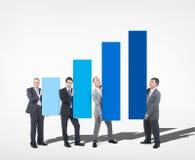 Grupo de hombre de negocios Holding Growth Chart Imágenes de archivo libres de regalías