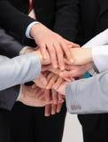 Grupo de hombres de negocios con las manos junto Imágenes de archivo libres de regalías