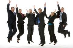 Grupo de hombres de negocios que saltan en el aire Fotos de archivo libres de regalías