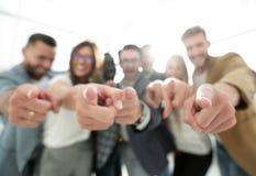 Grupo de hombres de negocios acertados que señalan en usted Imagen de archivo libre de regalías