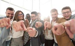 Grupo de hombres de negocios acertados que señalan en usted Imagen de archivo