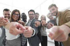 Grupo de hombres de negocios acertados que señalan en usted Foto de archivo libre de regalías