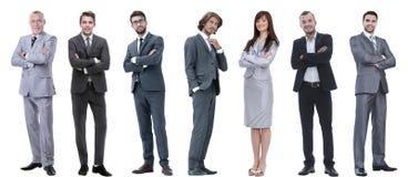 Grupo de hombres de negocios acertados que se colocan en fila fotos de archivo
