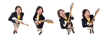 Grupo de hombres que tocan la guitarra Fotos de archivo