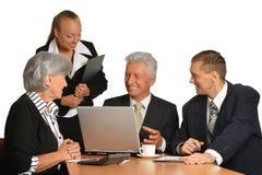 Grupo de homem de negócios com portátil Foto de Stock Royalty Free