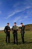 Grupo de homens de negócio que prestam atenção ao portátil Imagem de Stock Royalty Free