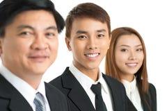 Homem de negócios novo isolado no fundo branco Fotografia de Stock Royalty Free