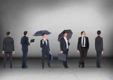 Grupo de homens de negócios que olham nos mesmos sentidos Imagem de Stock