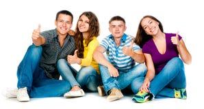 Grupo de jovens com polegares acima Fotografia de Stock
