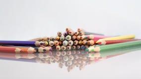 Grupo de lápices coloreados sostenido Foto de archivo libre de regalías