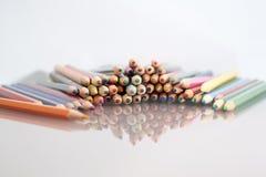 Grupo de lápices coloreados sostenido Imagen de archivo libre de regalías