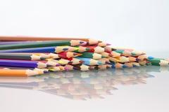 Grupo de lápices coloreados sostenido Imágenes de archivo libres de regalías