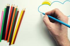 Grupo de lápis coloridos, e de tirar uma mão Imagens de Stock
