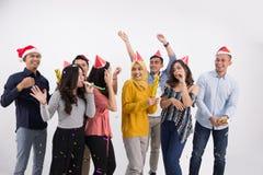 Grupo de la danza y del partido de gente asiática Imagenes de archivo