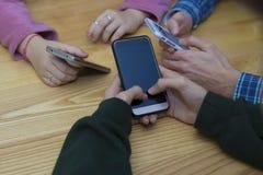Grupo de la mano con el móvil fotos de archivo