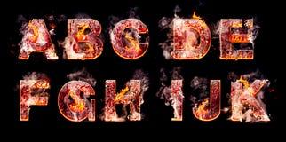 Grupo de letras ardentes do inferno Imagens de Stock