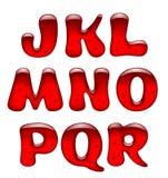 Grupo de letras principais vermelhas do alfabeto do gel e do caramelo isoladas sobre Imagens de Stock