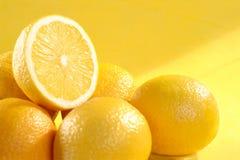 Grupo de limão no fundo amarelo Imagem de Stock Royalty Free