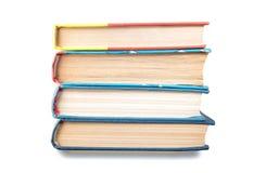 Grupo de livros empilhados isolados verticalmente no branco foto de stock royalty free