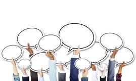 Grupo de mãos do negócio que guardam bolhas do discurso Imagens de Stock Royalty Free