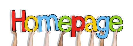 Grupo de mãos que guardam o homepage da palavra Fotografia de Stock Royalty Free