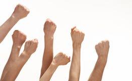 Grupo de mãos que mostram os punhos Imagem de Stock