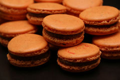 Grupo de macarons alaranjados Foto de Stock