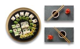 Grupo de maki e de rolos do sushi isolados no branco Fotos de Stock