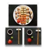 Grupo de maki e de rolos do sushi isolados no branco Imagem de Stock Royalty Free