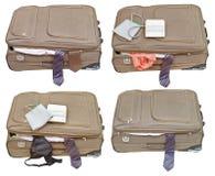 Grupo de malas de viagem com senhoras e roupa do negócio Foto de Stock