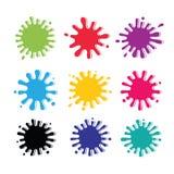 Grupo de manchas coloridas no fundo branco. Fotos de Stock