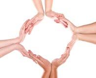 Grupo de manos que forman un círculo Imágenes de archivo libres de regalías