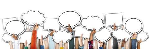 Grupo de manos que llevan a cabo burbujas del discurso Imagen de archivo libre de regalías