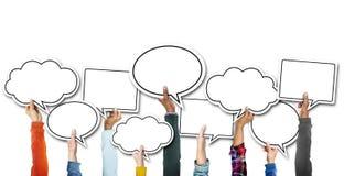 Grupo de manos que llevan a cabo burbujas del discurso Imagenes de archivo