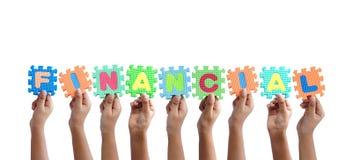 Grupo de manos que llevan a cabo palabra financiera Imagen de archivo