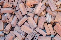 Grupo de materiales de construcción cuadrados de los ladrillos rojos Imagen de archivo