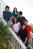 Grupo de miúdos em escadas Fotos de Stock Royalty Free