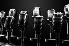 Grupo de micrófonos retros Imágenes de archivo libres de regalías