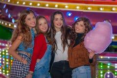 Grupo de muchachas en el carnaval justo Imagen de archivo libre de regalías