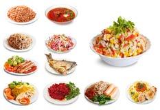 Grupo de muitas placas com alimento Imagens de Stock