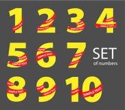 Grupo de números amarelos com fitas vermelhas ilustração stock