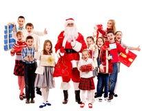 Grupo de niños con Papá Noel Fotos de archivo libres de regalías