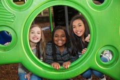 Grupo de niños que juegan junto afuera Fotografía de archivo libre de regalías