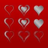 Grupo de nove corações isolados simples do vetor com teste padrão metálico de prata Fotografia de Stock Royalty Free