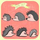 Grupo de ouriços bonitos dos desenhos animados Imagens de Stock Royalty Free