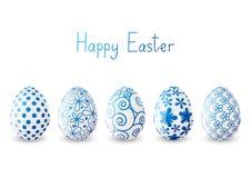 Grupo de ovos da páscoa com testes padrões azuis ilustração royalty free
