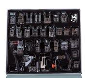 Grupo de pés do presser para a máquina de costura elétrica isolada no branco fotos de stock royalty free