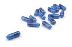 Grupo de píldoras azules Imágenes de archivo libres de regalías